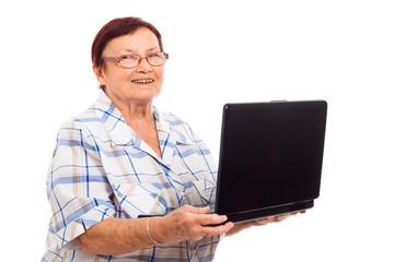 Happy senior woman with laptop