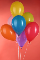 colorful balloons on red background