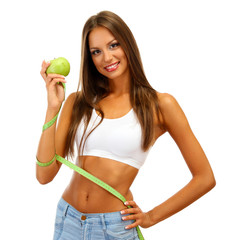 beautiful young woman with green apple and measure tape,