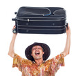 Ecstatic happy traveller with luggage