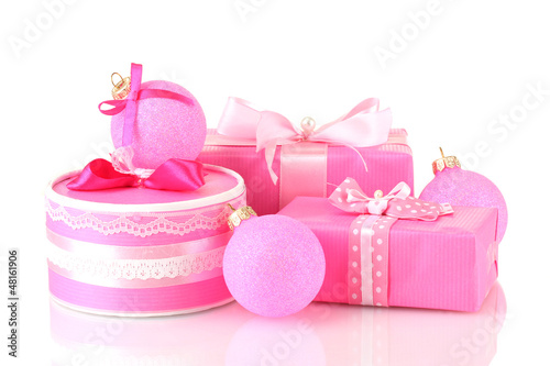 Colorful pink gifts with pink Christmas balls isolated on white