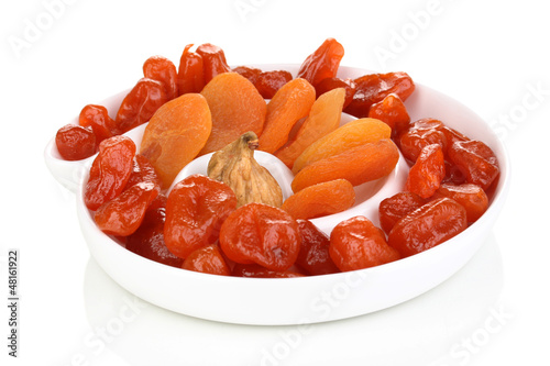 Dried fruits on plate isolated on white