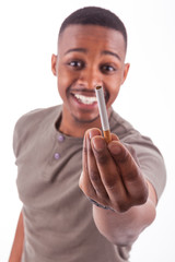 Young african american man offering a cigarette