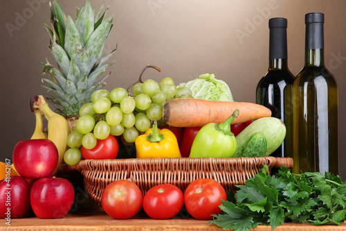 Composition with vegetables and fruits in wicker basket