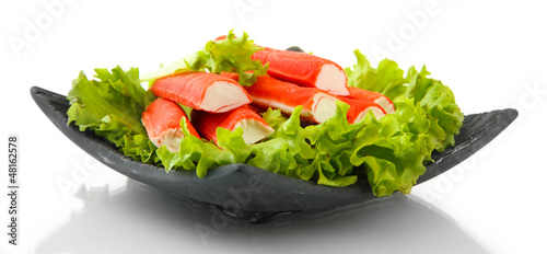 Crab sticks with lettuce leaves and lemon