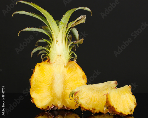 Sliced ripe pineapple isolated on black