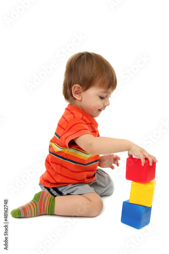 cute little boy with toy color cubes, isolated on white