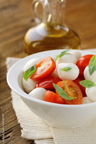 Italian Caprese salad with cherry tomatoes and baby mozzarella