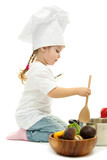 little girl in chef's hat with pan and vegetables, isolated