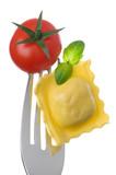 ravioli pasta tomato and basil on fork against white background