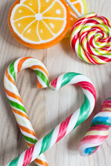 colorful lollipop on wooden background