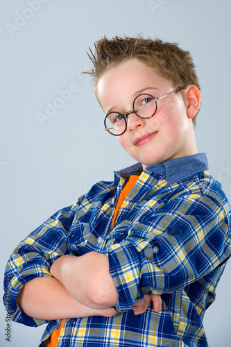 boy with stylish hair and round glasses