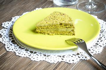 Pistachio cake on wooden background