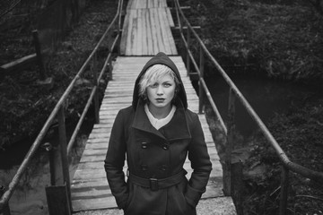 young beautiful woman on a bridge