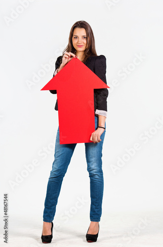 Beautiful woman holding an arrow pointing up