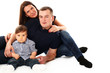 Beautiful caucasian couple with baby isolated