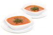 Image of bowls of hot red soup isolated