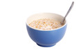Muesli mixed with fresh milk and spoon isolated