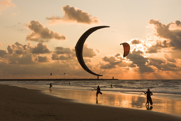 Kitesurfing in the evening at a Dutch beach