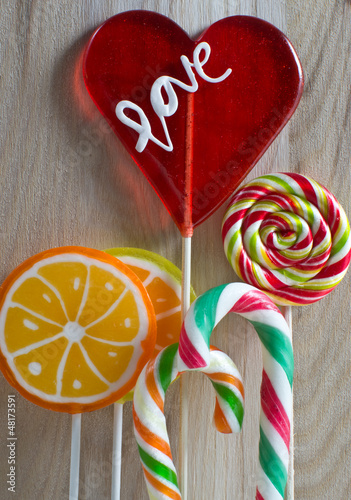 Colourful lollipop on wooden background