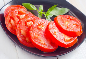 Fresh tomato with green aroma basil
