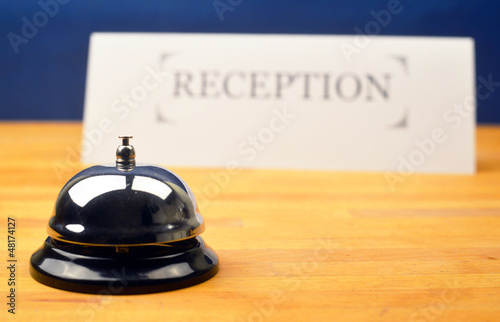 Hotel Bell with Reception Sign