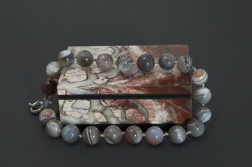 Ural stone casket with a necklace of decorative stone opal.