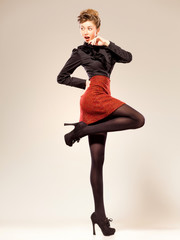 sexy woman dressed elegant doing a fashion shoot