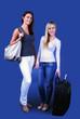 Happy traveling girls on blue background