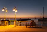 Fototapety Paar bei Sonnenuntergang