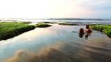 Cheerful couple swimming in Bali lagoon