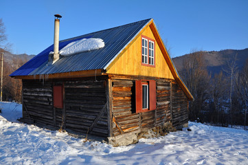 Small cabin in the mountains at winter