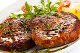 Fototapety Grilled steaks and vegetables