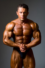 Bodybuilder showing his muscles