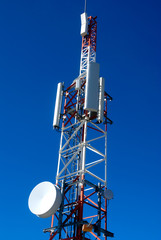 mobile phone  relay antennas on deep blue sky