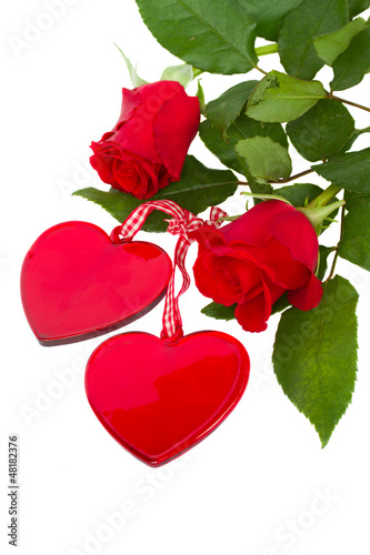 two glass hearts with roses