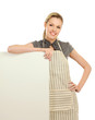 A smiling woman wearing apron and posing
