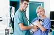 Veterinarian Doctor Examining A Rabbit's Pulse With Female Nurse