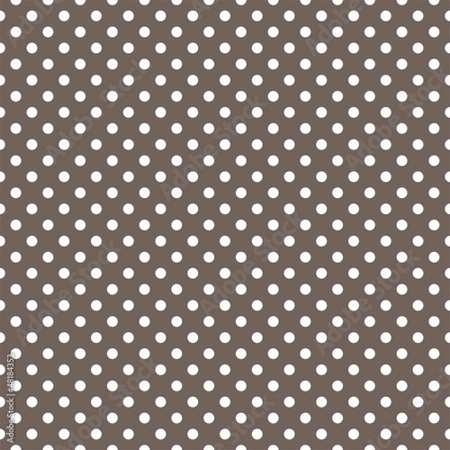 Polka dots seamless vector pattern texture on brown background