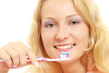 A young woman brushing teeth, closeup, isolated on white