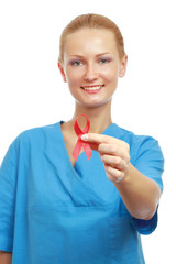 A female doctor showing a red ribbon as a symbol