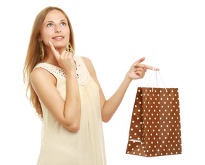Portrait of a beautiful young woman with a shopping bag