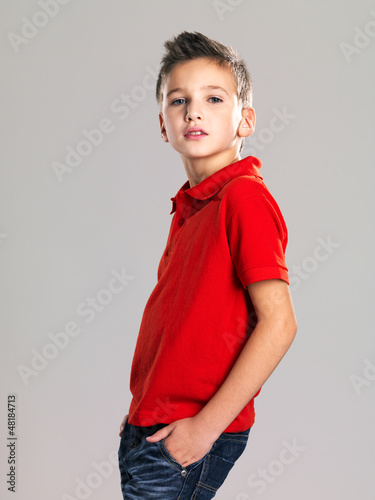 Pretty boy posing at studio as a fashion model.