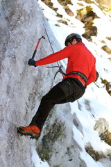 man climbing on ice
