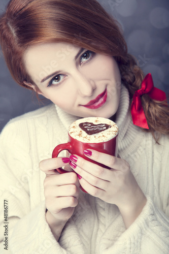 Redhead girl with red coffee cup at. St. Valentine's Day