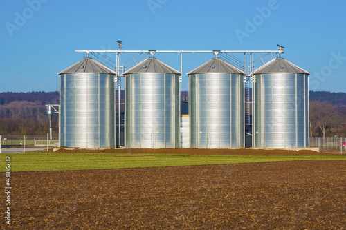 silver silo in rural landscape