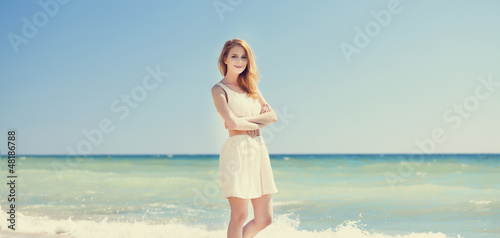 Young redhead girl at the beach.