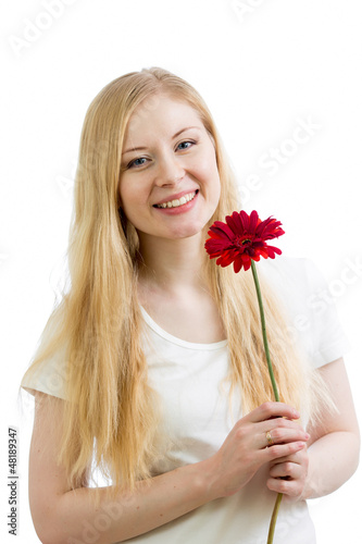 Portrait of a young woman with flower
