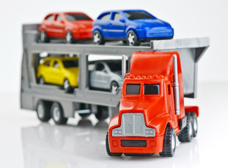 Toy cars transported on a truck plastic
