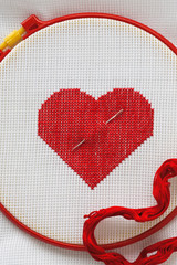 Heart embroidered cross